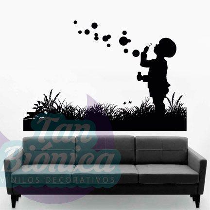 Niño en el pasto tirando burbujas. Vinilos Adhesivos decorativos, stickers, empavonados y fotomurales. Baratos y económicos, Pegatinas para las paredes.